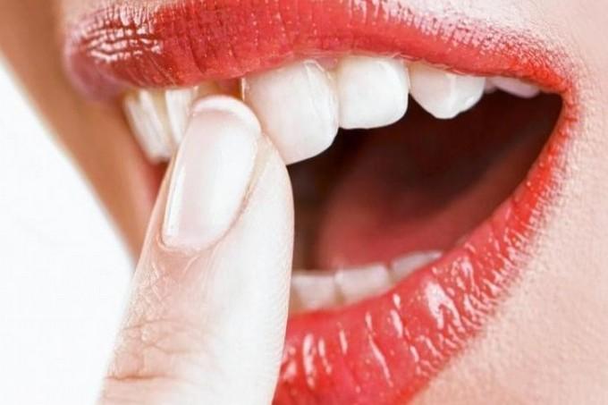 Причины шатания зубов